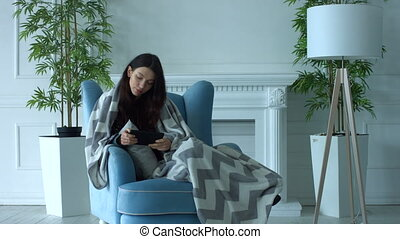 Relaxed woman surfing the net on digital tablet - Positive...