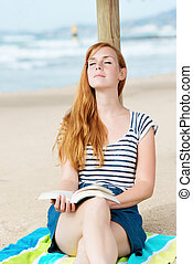 Relaxed Woman With Book On Beach