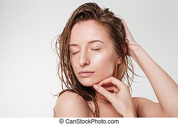 Relaxed woman with closed eyes