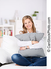 Relaxed Woman With Cushion At Home