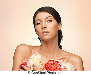 relaxed woman with flowers