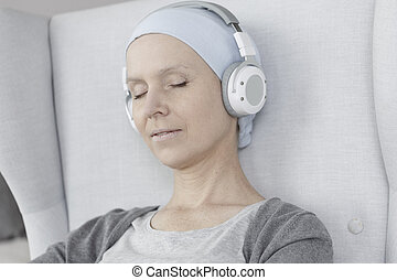 Relaxed woman with headphones on