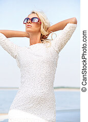 Relaxed woman with huge sunglasses