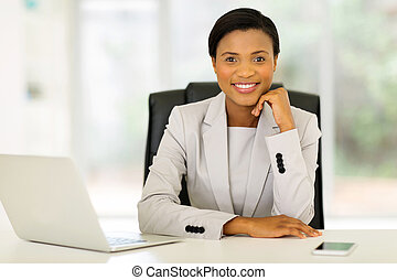 young african corporate worker sitting in office