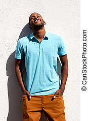 Relaxed young african man standing with his hands in pocket
