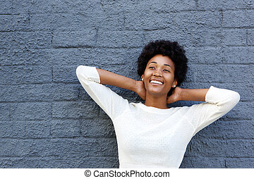 Relaxed young african woman looking away and smiling