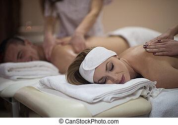 couple receiving a back massage