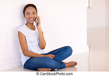 young black woman talking on cell phone