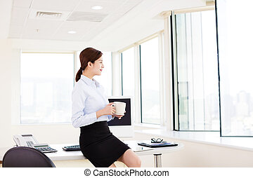 relaxed Young  business woman  in the office