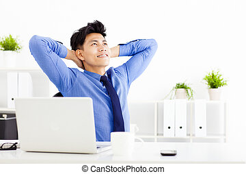 relaxed Young businessman working in the  office