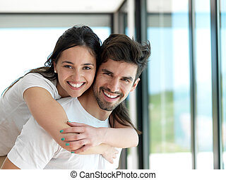 relaxed young couple at home - romantic happy young couple...