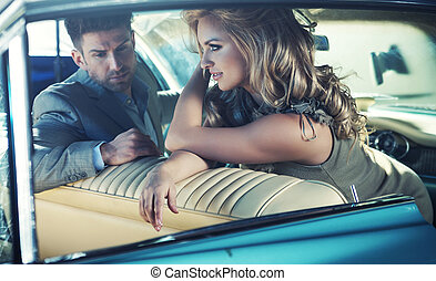 Relaxed young couple in the retro car - Relaxed young...