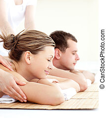 Relaxed young couple receiving a back massage