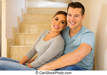 young couple sitting on stairs - relaxed young couple...