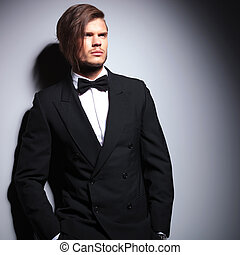 fashion model in suit with bow tie looking away