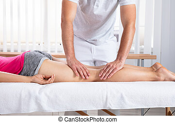 Female Patient Receiving Massage By Therapist