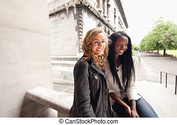 Relaxed young friends smiling