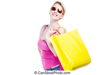 Relaxed young girl with shopping bag