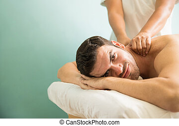 Relaxed young man at a health spa