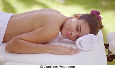 Relaxed young woman at an outdoor spa