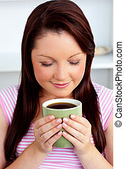 Relaxed young woman enjoying her coffee