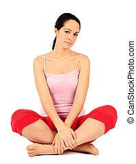cross legged - relaxed young woman sat cross legged on floor