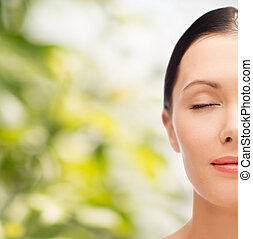 relaxed young woman with closed eyes - beauty, spa and...