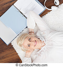 Relaxed Young Woman With Documents On Floor