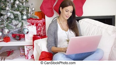 Relaxed young woman working on her laptop