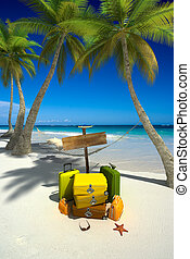 Relaxing arrival - Yellow luggage, hanging hammock, blank ...