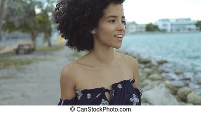 Relaxing black woman enjoying fresh wind