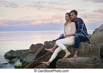 Relaxing couple on the rocks