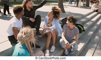 Relaxing diverse friends on street - Cool trendy multiethnic...