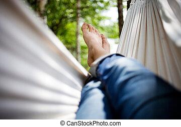 Relaxing in hammock - Woman relaxing in hammock