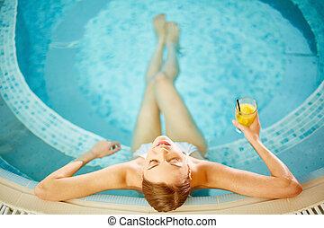 Relaxing in pool - Beautiful girl in bikini relaxing in ...