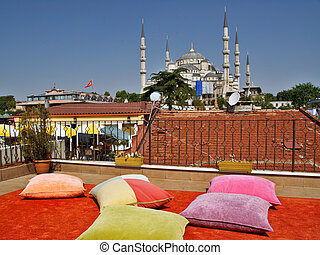 Pillows in rooftop terrace overlooking Blue Mosque