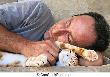 Relaxing man and cat on sofa.