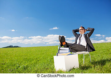 Relaxing man - Young businessman relaxing in Greenfield...