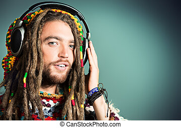 relaxing music - Portrait of a happy rastafarian young man...