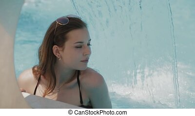 Relaxing of young woman in bikini at hotel spa in pool -...