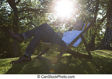 Relaxing on a deck chair