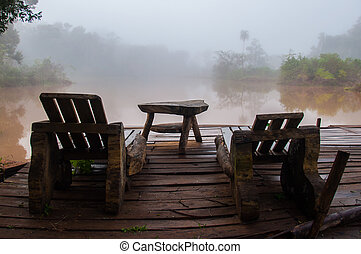 Relaxing on a foggy lake, early morning, Argentina