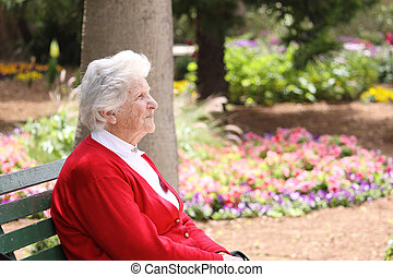 relaxing on a park bench - an old caucasian octogenarian...