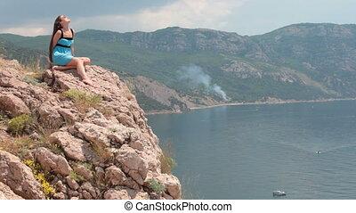 relaxing on rock by ocean