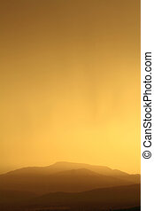 Relaxing sunset with silhouette of mountain range
