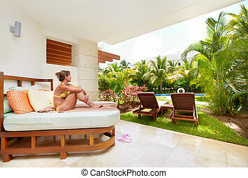 Relaxing woman at caribbean resort.