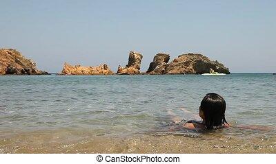 relaxing woman in the ocean