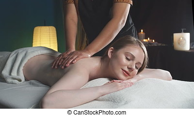 Relaxing woman in wellness beauty spa having aroma therapy...