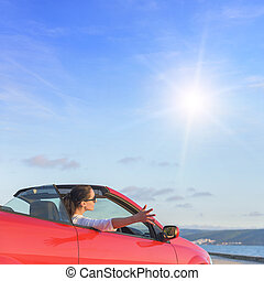 Relaxing woman on the beach in the car.