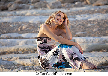 Relaxing woman on the rocks